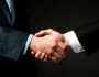 Business partners shaking hands, closeup shot