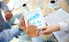 Business work-group analyzing financial data to develop new strategy